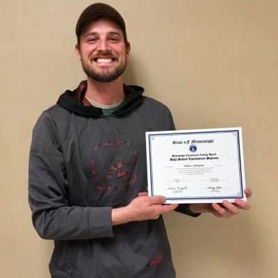 Photo of Dustin Hammond with Certificate