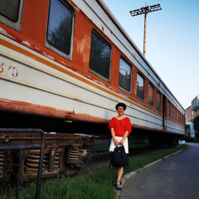 "Qi ""Ann"" Zhang standing in front of train"